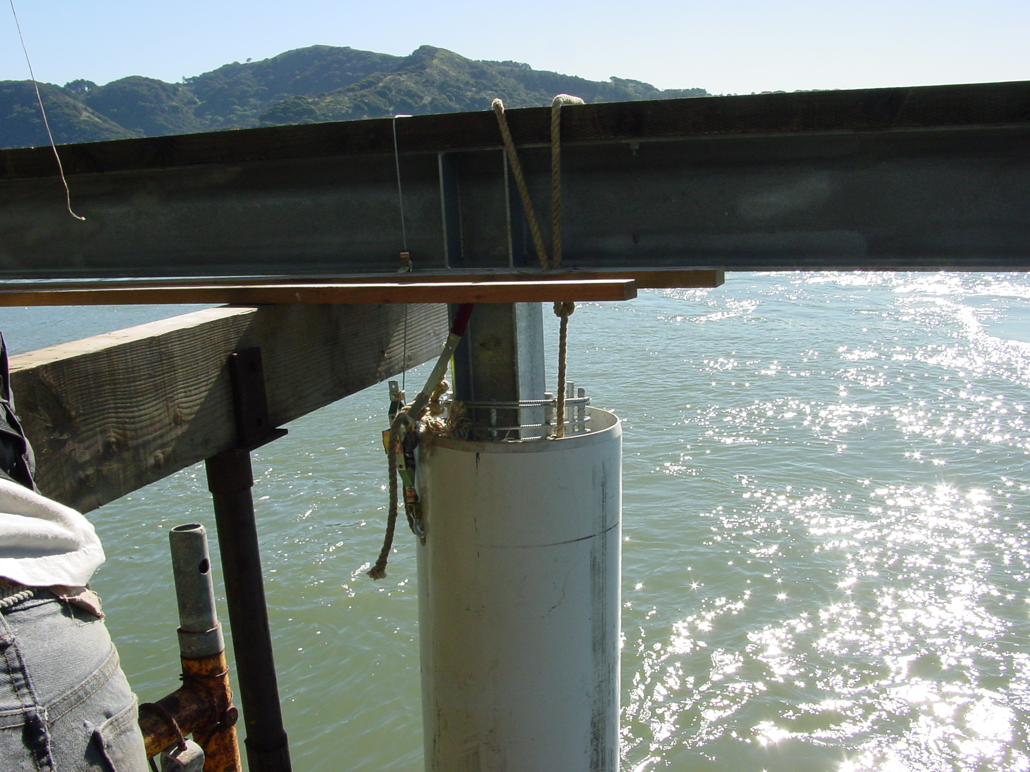 Installed pier and beam system over water