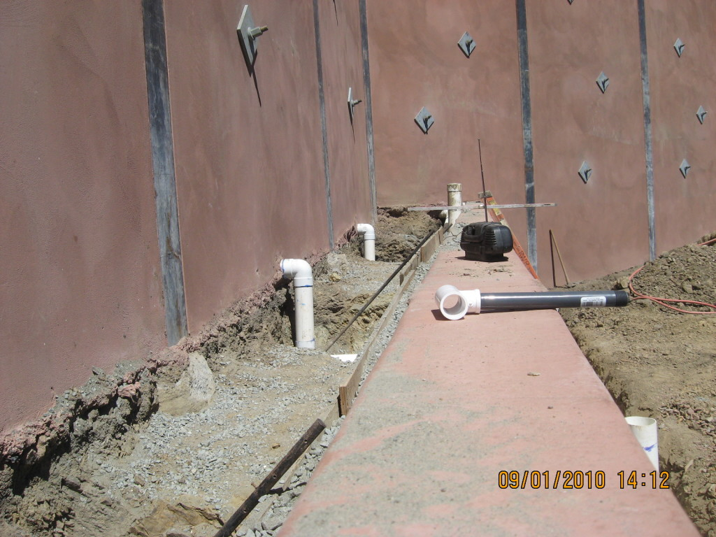 Retaining wall drainage outlet pipes