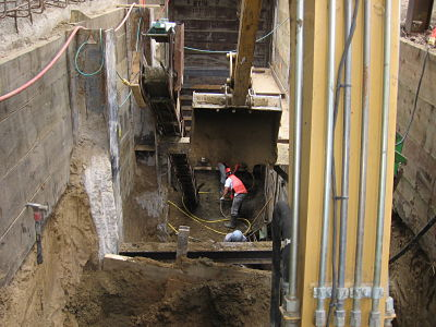 Excavating access pit to reinforce hospital foundation