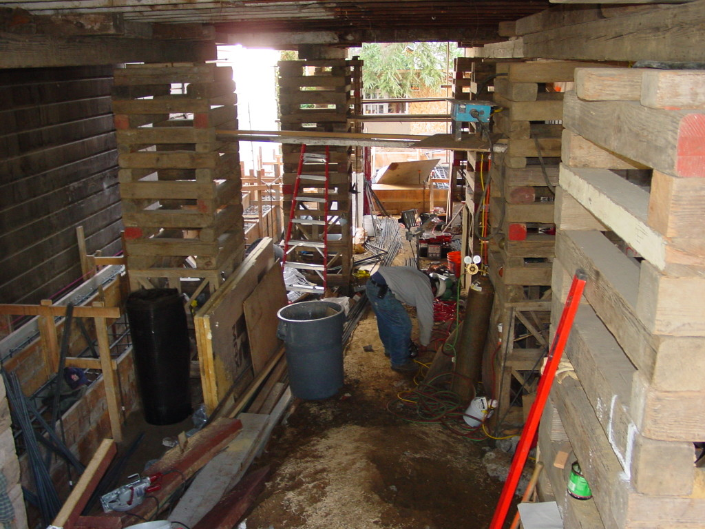 Existing home supported on shoring in order to remove foundation