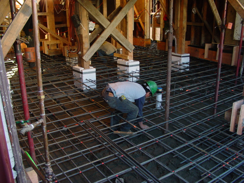 New mat slab foundation being installed under existing home