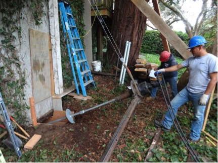 Helical anchor installation to stabilize existing foundation