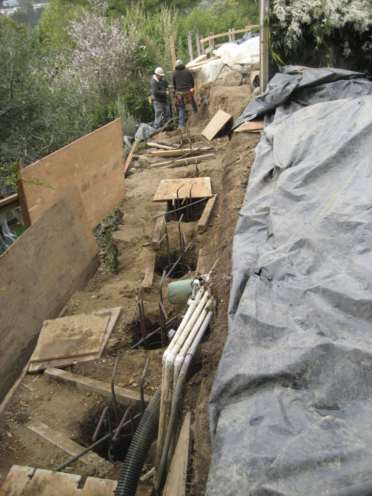 Stabilizing hillside with deep piers, ready to pour