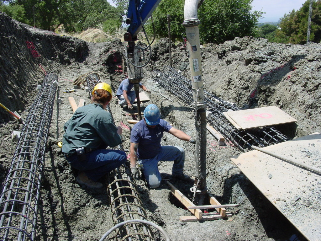 Pouring piers for landside repair, with reinforcing cages shown on ground