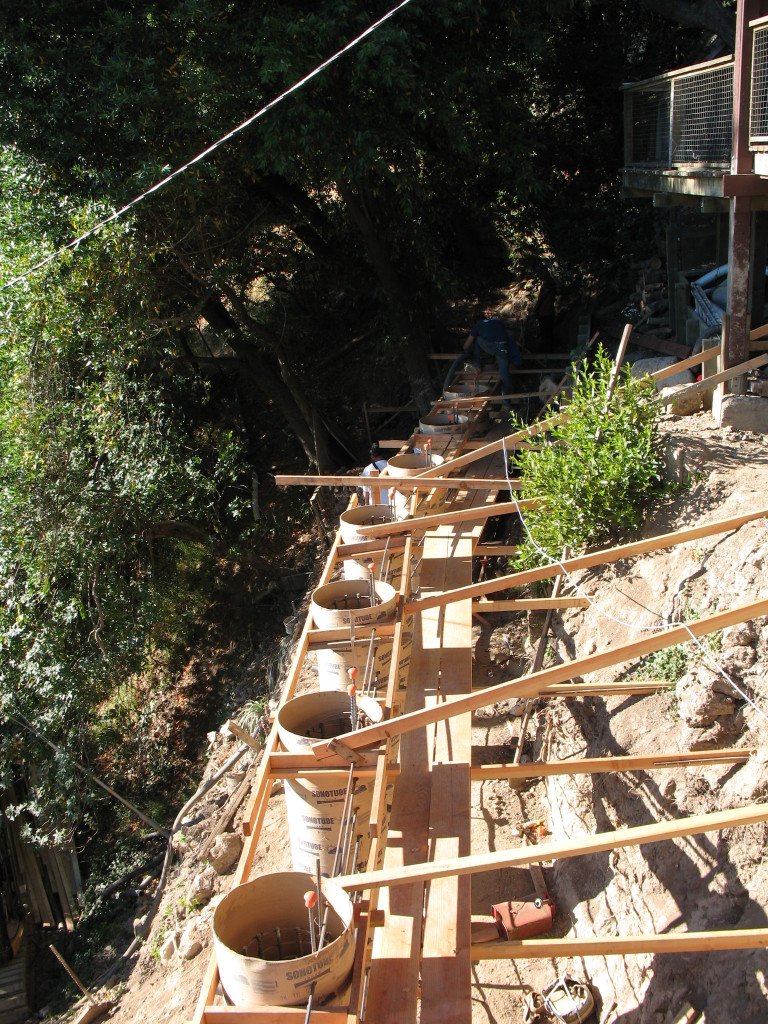 Sonotube-formed piers for retaining wall