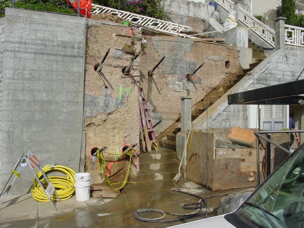 Wall repair with tie-backs
