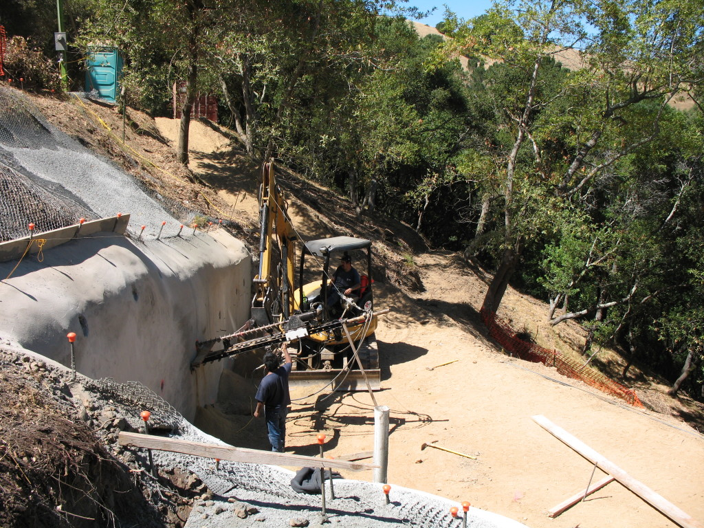 Tieback installation in shotcrete wall