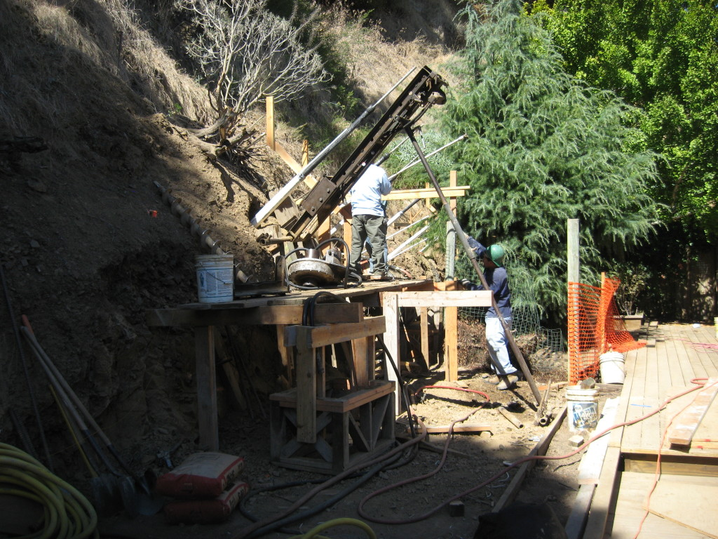 Drilling into hillside for tieback installation