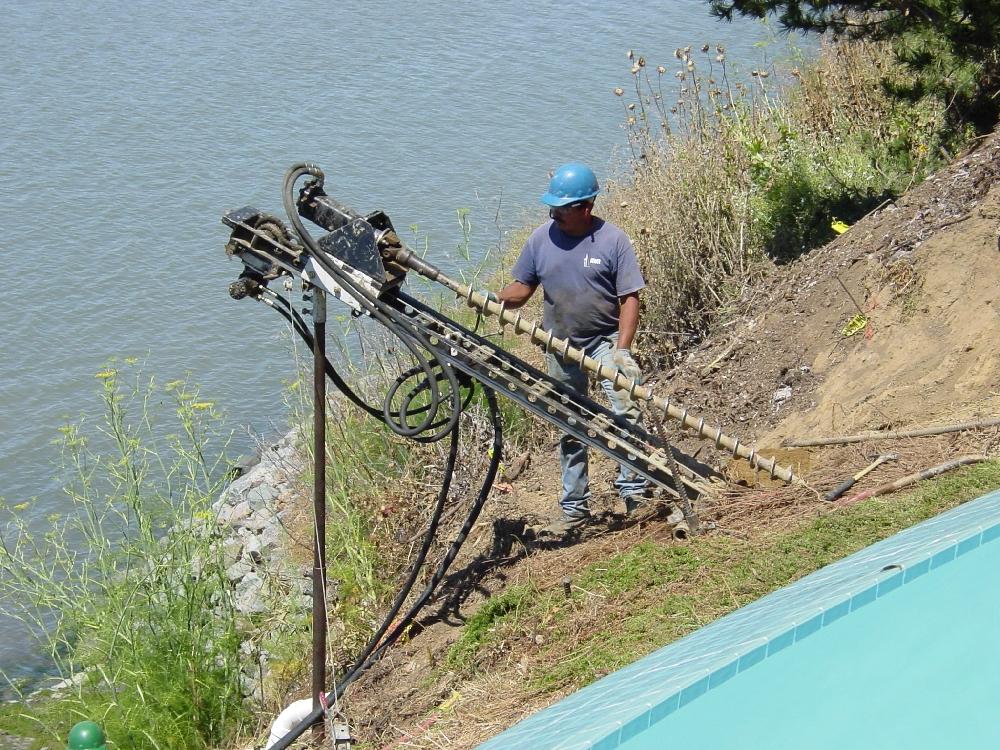 Tieback drilling in remote hillside location