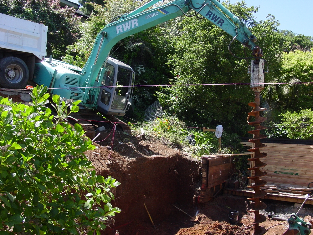 Track rig drilling piers for retaining wall