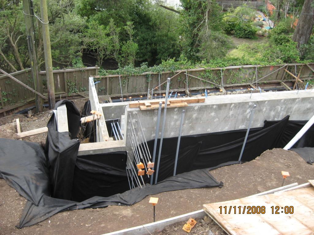 Installation of sub-drain system behind foundation wall